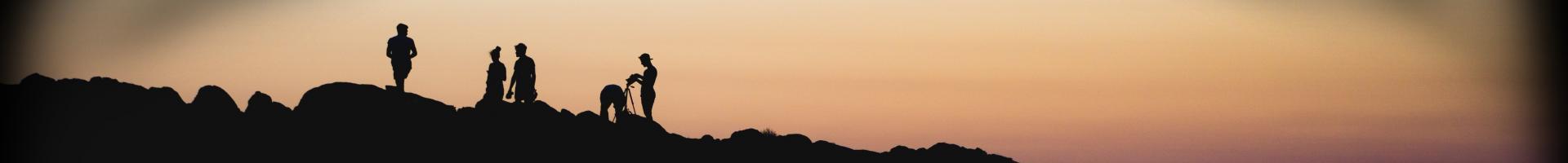 Catholic Climate Covenant - people on rocky landscape