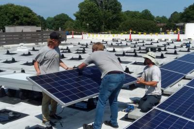 Workers install solar panels on the roof of Immaculate Conception Catholic Church in Hampton, Virginia. (Courtesy of Fr. John Grace)